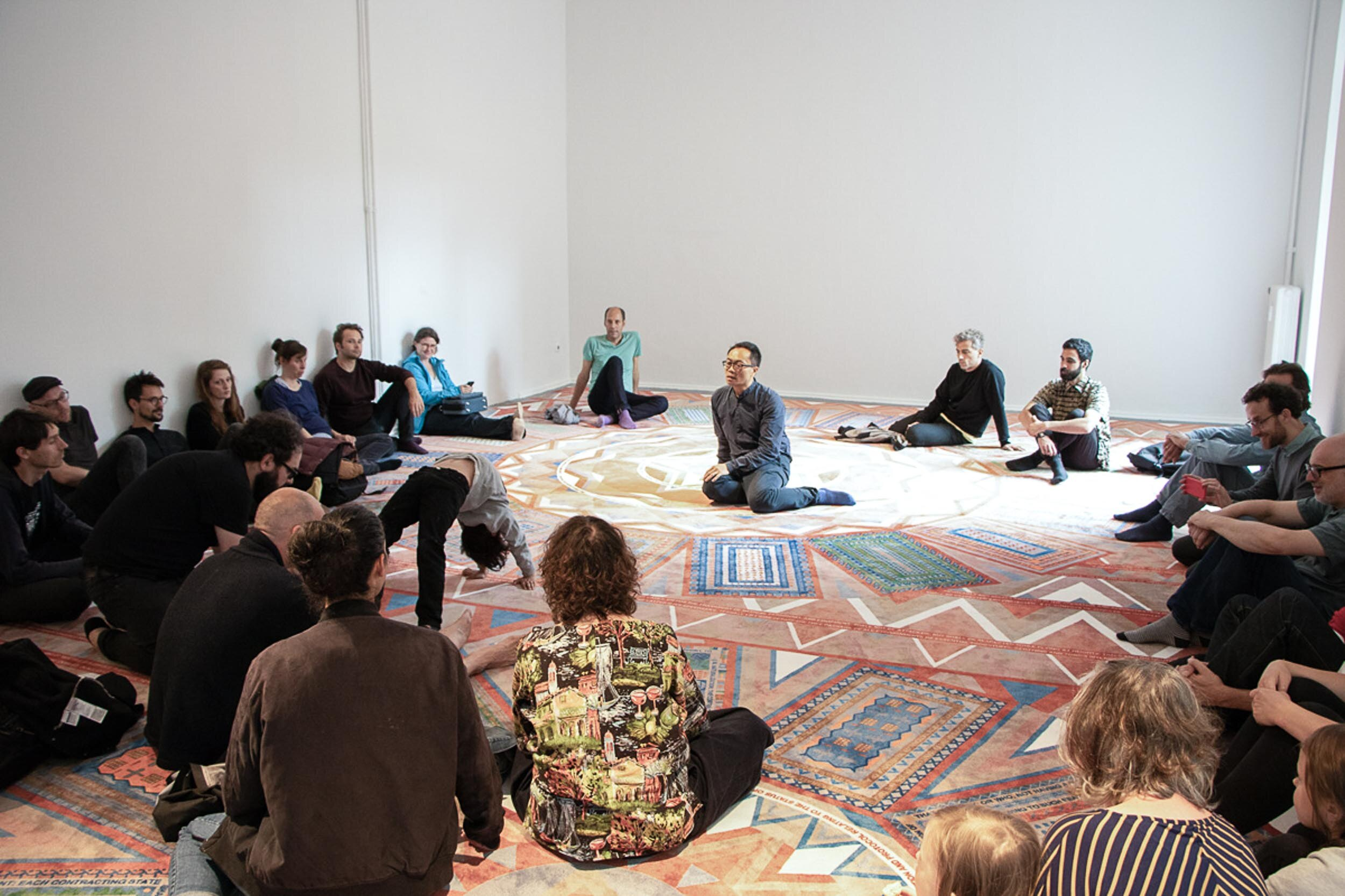 Anh-Linh Ngo with visitors on Manuel Herz' Rights on Carpet during a tour through the exhibition. Photo: Simone Gilges, © ifa